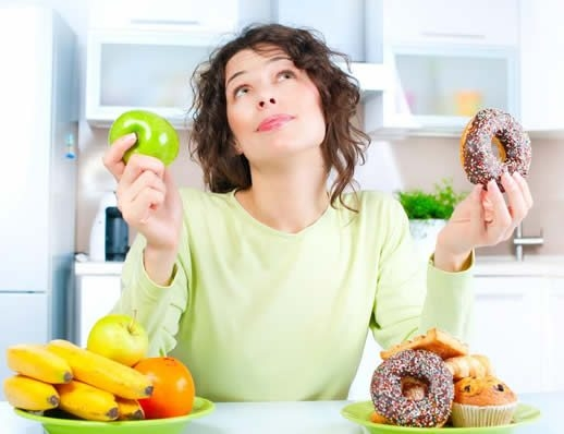 dietitian guide to indulgence woman choosing to eat fruit or donut